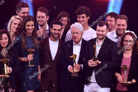 German TV host Frank Elstner (C-R) on stage with other winners after receiving the 'Best Newcomer' award during the 'YouTube Goldene Kamera Digital Award 2019' ceremony in Berlin, Germany, 26 September 2019. The best German web video producers are awarded at the event.