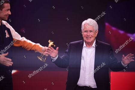 German TV host Frank Elstner (R) gestures prior to receiving the 'Best Newcomer' award from German TV host and Kai Pflaume (L) during the 'YouTube Goldene Kamera Digital Award 2019' ceremony in Berlin, Germany, 26 September 2019. The best German web video producers are awarded at the event.