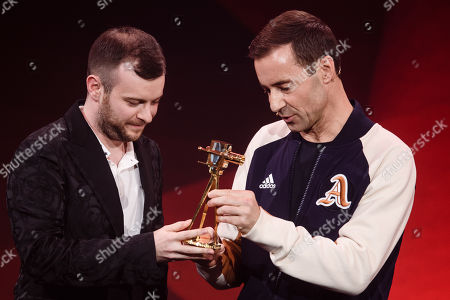 German YouTuber Domtendo (L) receives the 'Best of Letâ??s Play and Gaming' award from German TV host and laudator Kai Pflaume (R) during the 'YouTube Goldene Kamera Digital Award 2019' ceremony in Berlin, Germany, 26 September 2019. The best German web video producers are awarded at the event.