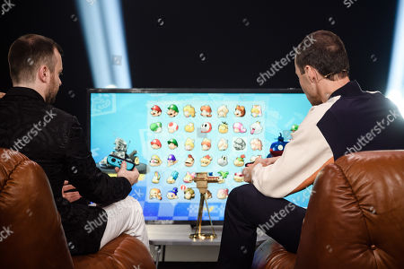German YouTuber Domtendo (L) German TV host and laudator Kai Pflaume (R) play a platform game during the 'YouTube Goldene Kamera Digital Award 2019' ceremony in Berlin, Germany, 26 September 2019. The best German web video producers are awarded at the event.
