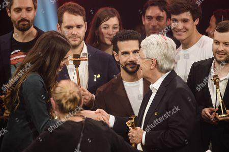 Turkish-German YouTuber Saliha Ozcan (L) and German TV host Frank Elstner (3-R) shake hands during the 'YouTube Goldene Kamera Digital Award 2019' ceremony in Berlin, Germany, 26 September 2019. The best German web video producers are awarded at the event.
