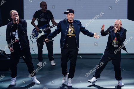 Stock Photo of Musicians of the German group Die Fantastischen Vier, Michael Bernd Schmidt aka Smudo (L), Michael Beck aka Michi Beck (3-L) and Thomas Duerr aka Thomas D (R) perform during the 'YouTube Goldene Kamera Digital Award 2019' ceremony in Berlin, Germany, 26 September 2019. The best German web video producers are awarded at the event.
