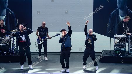 Musicians of the German group Die Fantastischen Vier, Michael Bernd Schmidt aka Smudo (2-L), Michael Beck aka Michi Beck (4-L), Thomas Duerr aka Thomas D (5-L) and Andreas Rieke aka And.Ypsilon (R) perform during the 'YouTube Goldene Kamera Digital Award 2019' ceremony in Berlin, Germany, 26 September 2019. The best German web video producers are awarded at the event.