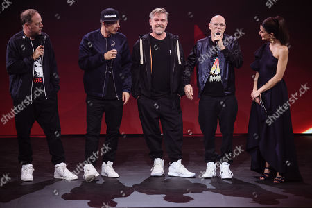 Stock Picture of Musicians of the German group Die Fantastischen Vier, Michael Bernd Schmidt aka Smudo (L), Michael Beck aka Michi Beck (2-L), Andreas Rieke aka And.Ypsilon (3-L) and Thomas Duerr aka Thomas D (4-L) and host Linda Zervakis talk during the 'YouTube Goldene Kamera Digital Award 2019' ceremony in Berlin, Germany, 26 September 2019. The best German web video producers are awarded at the event.