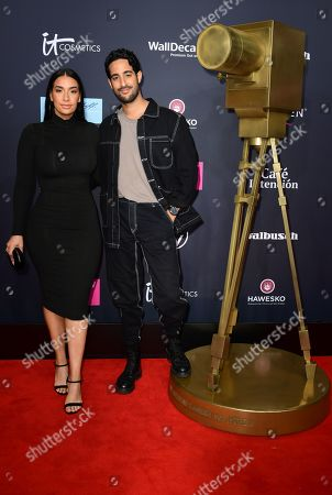 German-Tunisian influencer Sami Slimani (R) and his sister Lamiya Slimani pose on the red carpet of the 'YouTube Goldene Kamera Digital Award 2019' ceremony in Berlin, Germany, 26 September 2019. The best German web video producers will be awarded at the event.