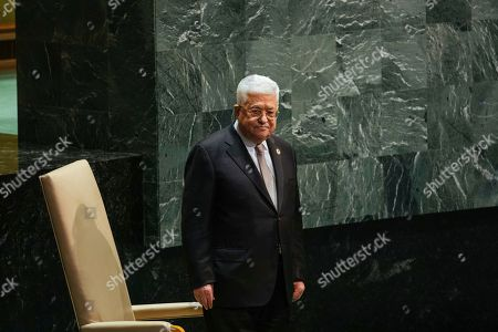 Palestinian President Mahmoud Abbas walks onto the stage to address the United Nations General Assembly at U.N. headquarters