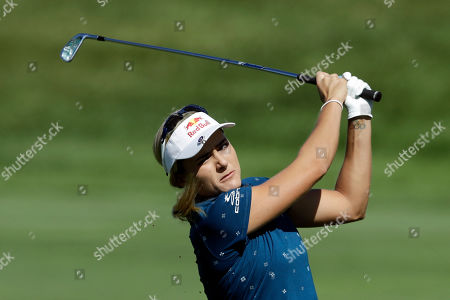 Lexi Thompson hits to the 13th green during the first round of the Indy Women in Tech Championship golf tournament, in Indianapolis