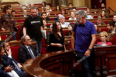 Stock Photo of (R-L) Catalan pro-independence CUP party's members in Parliament Carles Riera, Maria Sirvent, Vidal Aragones and Natalia Sanchez abandon a plenary session at Catalonian regional Parliament in protest to the provisional detention decreed for the seven members of the Republic Defense Comittees (CDR), in Barcelona, Spain, 26 September 2019. The detained CDR members, who were arrested on 23 September, have been accused of planning violent actions and terrorism by Prosecution Office.