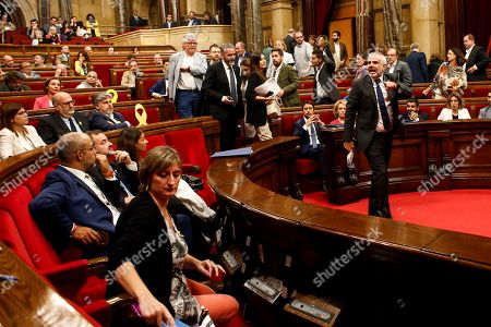 Stock Picture of Ciudadanos (Citizens) Parliamentary Spokesman Carlos Carrizosa (R) points to the independent deputies after being expelled from a plenary session at Catalonian regional Parliament due to a tense brawl between MPs, in Barcelona, Spain, 26 September 2019. The act takes place after Catalan pro-independence CUP party's members in Parliament Carles Riera, Maria Sirvent, Vidal Aragones and Natalia Sanchez abandoned the session in protest to the provisional detention decreed for the seven members of the Republic Defense Comittees (CDR). The detained CDR members, who were arrested on 23 September, have been accused of planning violent actions and terrorism by Prosecution Office. EFE/ Quique Garcia