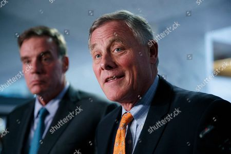 Richard Burr, Mark Warner. Sen. Richard Burr, R-N.C., right, chairman of the Senate Intelligence Committee, and Sen. Mark Warner, D-Va., committee vice chair, speak to the media after receiving closed briefings from Acting Director of National Intelligence Joseph Maguire and National intelligence inspector general Michael Atkinson, on Capitol Hill in Washington