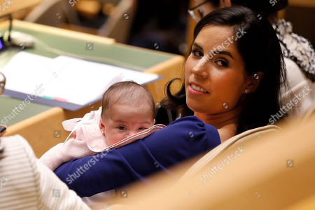 The first lady of El Salvador, Gabriela Rodriguez de Bukele, holds her new baby Layla in the United Nations General Assembly