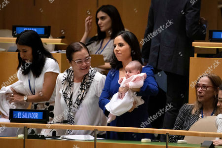 Stock Image of El Salvador's First Lady Gabriela Rodriguez de Bukele, with her daughter Layla, attends President Nayib Bukele's address to the United Nations General Assembly at U.N. headquarters