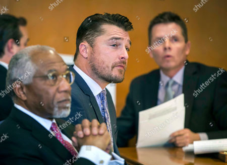 Iowa farmer and former TV reality show celebrity Chris Soules, center listens during a hearing in court in Independence, Iowa. Soules has pleaded guilty in a fatal crash last year near his home in northern Iowa. In an agreement with prosecutors announced Tuesday, Nov. 13, 2018, Soules pleaded guilty to a reduced charge of leaving the scene of a serious injury accident. (Rodney White/The Des Moines Register via AP, Pool, File)