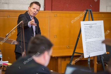 """Defense attorney Robert Montgomery for former """"Bachelor"""" star Chris Soules presents during a hearing in Buchanan County District Court Monday, Nov. 27, 2017, in Independence, Iowa. Lawyers for Soules' have asked a judge to dismiss the charge against him stemming from his rear-end crash that killed a farmer driving a tractor. (Rodney White/The Des Moines Register via AP, Pool)"""