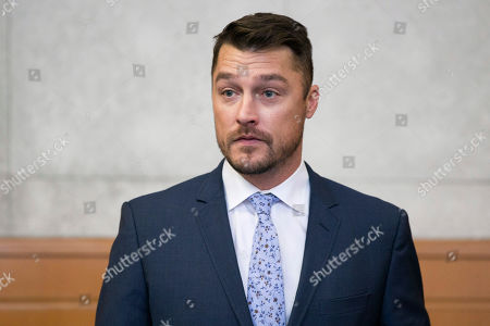 """Reality TV star Chris Soules, of """"The Bachelor,"""" left, gets up to leave the courtroom after his sentencing was delayed, Tuesday, May 21, 2019, in Independence, Iowa. Soules pleaded guilty to a misdemeanor for leaving the scene after rear-ending a slow-moving tractor driven by farmer Kenneth Mosher. (Kelly Wenzel/The Courier via AP, Pool)"""