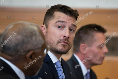 """Reality TV star Chris Soules, of """"The Bachelor,"""" center, sits in the courtroom for his sentencing Tuesday, May 21, 2019, in Independence, Iowa. Soules pleaded guilty to a misdemeanor for leaving the scene after rear-ending a slow-moving tractor driven by farmer Kenneth Mosher in 2017. (Kelly Wenzel/The Courier via AP, Pool)"""