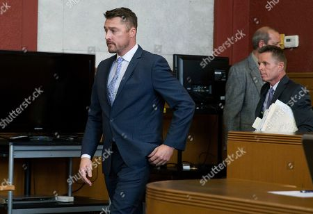 """Reality TV star Chris Soules, of """"The Bachelor,"""" left, arrives in the courtroom for his sentencing on leaving-the-scene charges, Tuesday, May 21, 2019, in Independence, Iowa. (Kelly Wenzel/The Courier via AP, Pool)"""