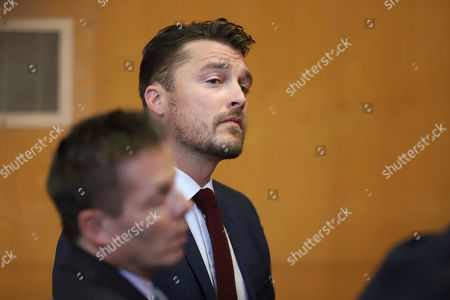 """Stock Picture of Reality TV star Chris Soules, of """"The Bachelor,"""" appears at a hearing in Buchanan County District Court with his lawyer Robert Montgomery, foreground, Thursday, Sept. 14, 2017, in Independence, Iowa. Soules is charged with leaving the scene of an April 24 crash in which he rear-ended a tractor, killing 66-year-old Kenneth Mosher. (Matthew Putney/The Courier via AP, Pool)"""
