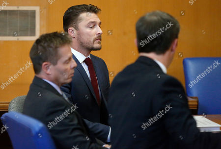 """Stock Photo of Reality TV star Chris Soules, of """"The Bachelor,"""" center, appears at a hearing in Buchanan County District Court with his lawyer Robert Montgomery, left, and Brandon Brown, Thursday, Sept. 14, 2017, in Independence, Iowa. Soules is charged with leaving the scene of an April 24 crash in which he rear-ended a tractor, killing 66-year-old Kenneth Mosher. (Matthew Putney/The Courier via AP, Pool)"""