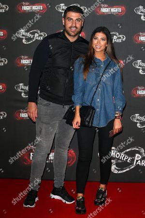 Stock Photo of Jon Clark and girlfriend