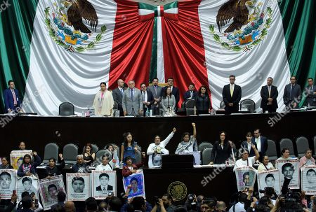 Relatives and support groups of the 43 Ayotzinapa's students, missing since 5 years ago, demonstrate at the Deputy Chamber in Mexico City, Mexico, 26 September 2019. The disappearance of the students of the Normal Rural School Raul Isidro Burgos of Ayotzinapa, in the southern state of Guerrero, marked the beginning of the popularity decline of President Enrique Pena Nieto (2012-2018), of the Institutional Revolutionary Party (PRI), during whose term the 'historical truth' of the case was enunciated, an official version rejected by organizations and relatives of victims.