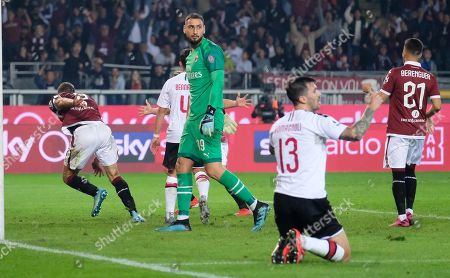 AC Milan goalkeeper Gianluigi Donnarumma (C) looks on as Torino's Andrea Belotti (L) celebrates his second goal during the Italian Serie A soccer match between Torino FC and AC Milan at the Olimpico Grande Torino stadium in Turin, Italy, 26 September 2019.