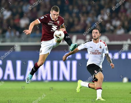 Torino's Andrea Belotti (L) controls the ball in front of AC Milan's Davide Calabria during the Italian Serie A soccer match between Torino FC and AC Milan at the Olimpico Grande Torino stadium in Turin, Italy, 26 September 2019.