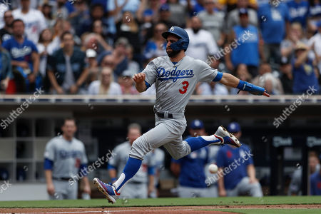 Los Angeles Dodgers' Chris Taylor scores from first off a single by Max Muncy during the sixth inning of a baseball game against the San Diego Padres, in San Diego