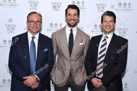 Stock Picture of Simon Cundey, MD of Henry Poole, Savile Row Gin Brand Ambassador and Investor David Gandy and Stewart Lee, CEO & founder of Savile Row Gin