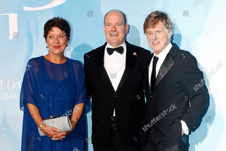 Prince Albert II of Monaco (C), US actor Robert Redford (R) and his wife Sibylle Szaggars (L) attend the 3rd Monte-Carlo Gala for the Global Ocean 2019 in Monaco, 26 September 2019. The Monte Carlo Gala for the Global Ocean, hosted by the Prince Albert II of Monaco Foundation, is a fundraising auction, to support the foundation's marine conservation initiatives.