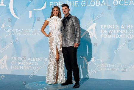US musician Robin Thicke (R) and April Love Geary (L) attend the 3rd Monte-Carlo Gala for the Global Ocean 2019 in Monaco, 26 September 2019. The Monte Carlo Gala for the Global Ocean, hosted by the Prince Albert II of Monaco Foundation, is a fundraising auction, to support the foundation's marine conservation initiatives.