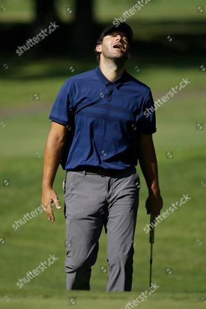 Tony Romo reacts after missing a birdie putt from below the 17th green during the first round of the Safeway Open PGA golf tournament, in Napa, Calif
