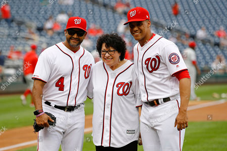Stock Photo of Sonia Sotomayor, Dave Martinez, Juan Soto. Supreme Court Justice Sonia Sotomayor, center, poses for a photo with Washington Nationals manager Dave Martinez, left, and left fielder Juan Soto after throwing out a ceremonial first pitch before a baseball game against the Philadelphia Phillies, in Washington