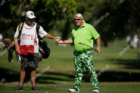 Stock Picture of John Daly prepares to putt on the 13th green of the Silverado Resort North Course during the first round of the Safeway Open PGA golf tournament, in Napa, Calif