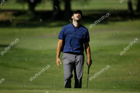 Stock Picture of Tony Romo reacts after missing a birdie putt from below the 17th green during the first round of the Safeway Open PGA golf tournament, in Napa, Calif