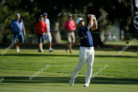 Francesco Molinari, of Italy, follows his approach shot to the 18th green of the Silverado Resort North Course during the first round of the Safeway Open PGA golf tournament, in Napa, Calif