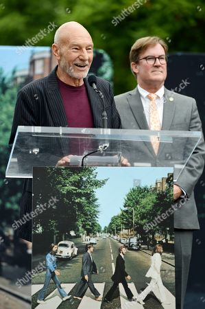 """Sir Patrick Stewart. Actor Patrick Stewart speaks at an event celebrating the 50th anniversary of the classic Beatles album """"Abbey Road"""" in front of the Capitol Records building, in Los Angeles. Stewart helped to dedicate the Vine Street crosswalk in front of Capitol Records as """"Abbey Road At Vine."""" At right in the photo is Los Angeles Board of Public Works President Kevin James"""