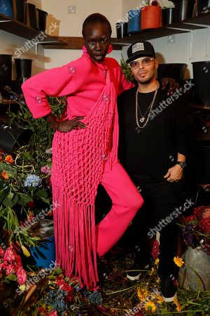 Alek Wek and guest in the front row