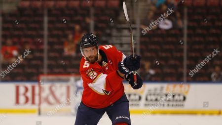 Florida Panthers defenseman Aaron Ekblad warms up before the start of a preseason NHL hockey game against the Tampa Bay Lightning, in Sunrise, Fla