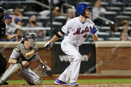 Stock Picture of Zack Wheeler, Tyler Heineman. New York Mets' 'Zack Wheeler watches his RBI-single during the seventh inning of a baseball game against the Miami Marlins, in New York. Marlins catcher Tyler Heineman, left, looks on