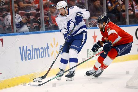 Tyler Johnson, Aaron Ekblad. Tampa Bay Lightning forward Tyler Johnson, left, and Florida Panthers defenseman Aaron Ekblad compete for the puck during the first period of a preseason NHL hockey game, in Sunrise, Fla