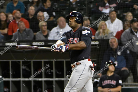 Cleveland Indians right fielder Yasiel Puig (66) bats against the Chicago White Sox during the first inning of a baseball game, in Chicago