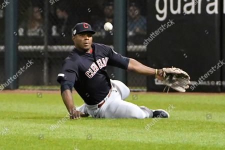 Cleveland Indians right fielder Yasiel Puig (66) can't catch a one RBI triple hit by Chicago White Sox's Jose Abreu (79) during the fifth inning of a baseball game, in Chicago