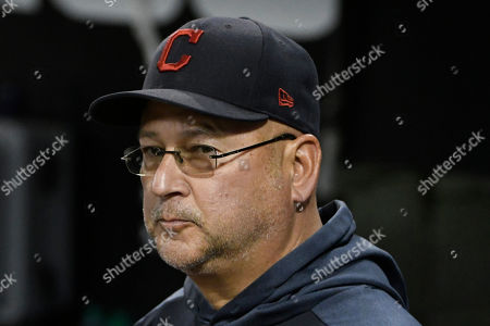 Stock Photo of Cleveland Indians manager Terry Francona looks out of the dugout before the team's baseball game against the Chicago White Sox, in Chicago