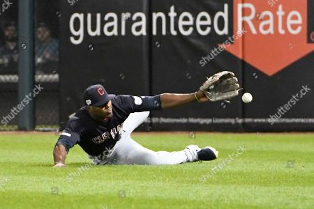 Cleveland Indians right fielder Yasiel Puig can't catch an RBI triple by Chicago White Sox's Jose Abreu during the fifth inning of a baseball game, in Chicago