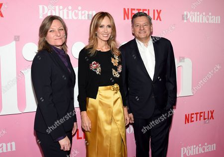 """Cindy Holland, Dana Walden, Ted Sarandos. Netflix VP content acquisition and original series Cindy Holland, left, Disney Television Studios chairman Dana Walden and Netflix chief content officer Ted Sarandos pose together at the premiere of Netflix's """"The Politician"""" at the DGA New York Theater, in New York"""