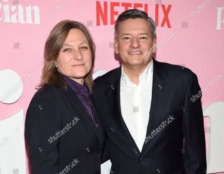 """Cindy Holland, Ted Sarandos. Netflix VP content acquisition and original series Cindy Holland, left, and Netflix chief content officer Ted Sarandos pose together at the premiere of Netflix's """"The Politician"""" at the DGA New York Theater, in New York"""