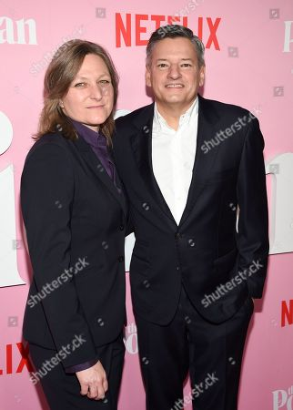 """Stock Picture of Cindy Holland, Ted Sarandos. Netflix VP content acquisition and original series Cindy Holland, left, and Netflix chief content officer Ted Sarandos pose together at the premiere of Netflix's """"The Politician"""" at the DGA New York Theater, in New York"""
