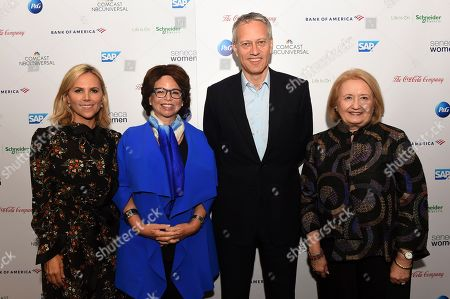 Stock Image of Tory Burch, Executive Chairman and Chief Creative Officer, Tory Burch LLC; Valerie Jarrett, Former Senior Advisor to President Obama; James Quincey, Chairman and CEO of The Coca-Cola Company; and Ambassador Melanne Verveer, co-founder Seneca Women, left to right, pose backstage before Seneca Women's forum, Fast Forward: Women in the Economy, at Metropolitan Museum of Art in New York. Today's forum looks at how individuals, communities and companies are advancing women and helping create progress. Visit SenecaWomen.com to learn more