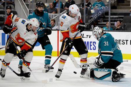 Martin Jones, Tobias Rieder, Derek Ryan. San Jose Sharks' Martin Jones, right, stops a shot in front of Calgary Flames' Tobias Rieder (16) and Derek Ryan (10) during the second period of a preseason NHL hockey game, in San Jose, Calif